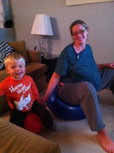 tired and bouncing on a birthing ball